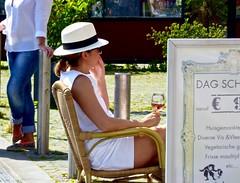 24 mei rokjes en terrasjes dag . (Franc Le Blanc .) Tags: people woman hat lumix sitting wine candid panasonic sit streetphoto seated shertogenbosch terrasje rokjesdag