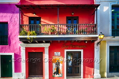 Colorful Historic Spanish Colonial Style House In Old San Juan (George Oze) Tags: door travel red usa detail horizontal architecture facade landscape outdoors island us colorful bright oldsanjuan puertorico pastel balcony unitedstatesofamerica scenic entrance streetphotography vivid nobody oldbuildings historic sanjuan spanish tropical northamerica caribbean charming quaint lampion houseexterior vividcolors historicdistrict wallmural buildingexterior callesansebastian casaborinquen buildingexteriors spanishcolonialarchitecturalelements puertoricovarious