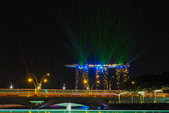 Layers of Lights (elenaleong) Tags: longexposure skyline singapore nightscape landmark citylights lasershow mbs traffictrails esplanadebridge esplanadepark boattrails sporeriver