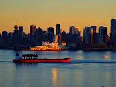 Caught in the golden light of the dying sun (peggyhr) Tags: sunset red canada skyline vancouver bc harbour freighter thegalaxy peggyhr level1photographyforrecreation thegalaxyhalloffame thelooklevel1red thelooklevel2yellow thelooklevel3orange thelooklevel4purple dsc05426a