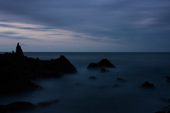Birjilandape (Marcos Lpez) Tags: mar largaexposicion rocas pescador atardecer crepusculo agua seda nubes costa playa piedras