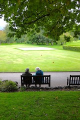 Sitting in the Park (timnutt) Tags: cumbria lakedistrict britain rural countryside green people sitting elderly old pensioners rest park bench tree