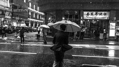 Rain in Hong Kong (outvizion) Tags: hongkong rain blackandwhite street umbrela people asia