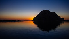Morro Bay - II - Pulling the plug on the sun (ḆΞ₪¡) Tags: ocean blue sunset color colour silhouette canon gold golden pacific vivid calm morrobay morrorock 30d 2013