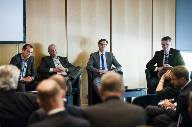 William Todts, Anders Berndtsson, Patrik Akerman and Nils-Gunnar Vågstedt listening to an attendee