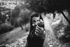 girl with flowers (gorbot.) Tags: blackandwhite monochrome rangefinder sicily roberta mmount leicam8 voigtlander28mmultronf19 riservanaturaleorientatapantalica