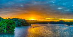 Sunset darkened by threatening clouds... (capvera) Tags: sunset orange lake green yellow reflections woods sony lac bleu hdr coucherdesoleil a7mii