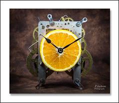 A Clockwork Orange (deltic22) Tags: orange fruit citrus colour clock mechanism time hands gears cogs timepiece table top studio