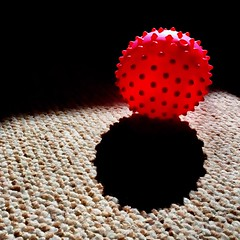 Bold (Caroline Oades) Tags: plastic spiky light striking bright anticipation waiting bold carpet shadow sunlight iphone5s iphone enlight exerciseball ball pink