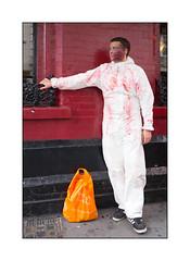 World Zombie Day 2016, West London, England. (Joseph O'Malley64) Tags: zombie worldzombieday2016 homeless charity stmungosbroadway candid portrait man madeup makeup brickwork pointing wroughtiron windows pavement basementgrille skylight plasticbag shoppingbag adayout