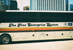 The Free Enterprise System (Tom Frundle) Tags: city chicago bus spring cityscape citylife chitown nik downtownchicago chicagoland chicagoil windycity 2015 charterbus fujix 185528 fujixe1