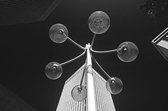 Looking up at lamp post with multiple bulbs and building with repeating lines and blue sky, Seattle Washington USA (Jim Corwin's PhotoStream) Tags: seattle city blackandwhite bw building geometric lines horizontal architecture contrast outdoors photography design streetlight downtown cityscape angle shapes angles bluesky nobody line lookingup lamppost lightanddark urbanscene buildingexterior repeatinglines multiplelightbulbs