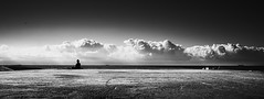 Watching the Sea (elgunto) Tags: barcelona beach panoramic zen relaxing people bw blackwhite clouds sky sea sonya7 canonfd28 manuallense