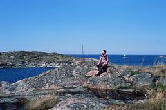 Uto island, Baltic sea, Finland (Iurii & Natali) Tags: blue sea summer portrait sky man color vintage finland landscape island spring stones may deep baltic analogue praktica uto mtl5