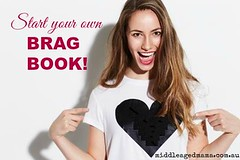 start your own brag book (jancamilleri) Tags: whitebackground wirelesstechnology toothysmile photography portrait youngwomen fashionmodel colorimage 2529years smiling pointing heartshape caucasianethnicity oneperson happiness love excitement confidence indoors waistup lookingatcamera studioshot frontview cheerful brownhair longhair tshirt beautifulwoman