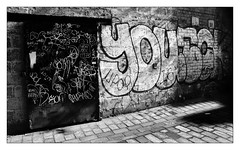 Glasgow Graffiti ( Jamie Mitchell) Tags: glasgow scotland scottish glaswegian grime gritty city urban decay abandoned barbeque gas wall tone tones tonal black white cigarettes dirty graffiti light shadows street