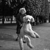 Walking the dog (skamelone) Tags: street blackandwhite dog white black paris france lady streetphotography olympus streetartist streeter em1