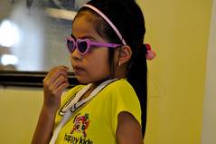 Pensive kid (Roving I) Tags: travel girls tourism sunglasses children hearts vietnam toothpicks happykids danang banahills