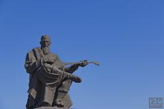 Just chillin' (Ray Whitby Photography) Tags: statue guitar kazakhstan astana dombra kurmangazy dumanhotel kazakhpoet