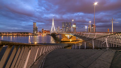 Rotterdam City Skyline (RickyLoca) Tags: city bridge light sky urban holland building cars netherlands colors lines skyline architecture modern night clouds skyscraper office rotterdam traffic dusk perspective walkway