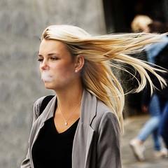 Wind in the  hair. (D80_441372) (Itzick) Tags: woman copenhagen windyday denmark candid smoke blonde d800 colorportrait itzick