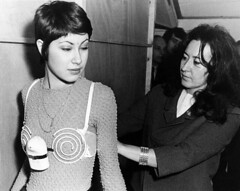 A model is seen trying on a spiral electric bra at the 20th International Show of Inventions in Brussels on March 13, 1971. The bra claimed to develop and strengthen the bust and was designed to vibrate while the person wearing it was at work. [960x765] (Histolines) Tags: show brussels history wearing electric work spiral person was march is 1971 model bra it retro trying bust international timeline while 13 seen claimed develop vibrate designed the vinatage strengthen a 20th historyporn inventions histolines 960x765 httpifttt210bkf9