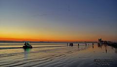 Seaview Beach, Karachi (Shehzaad Maroof Khan) Tags: pakistan sunset sea reflection beach nature water nikon waves bluehour karachi clifton sindh tides seaview