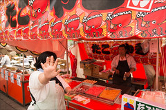 ueno-2612-ps-w (pw-pix) Tags: pictures red woman man cooking strange face japan tokyo weird stand eyes hand counter ueno tasty stall apron delicious snack round octopus gesture selling takoyaki spherical nophoto taito octopusballs takoyakipan nearshinobazupond nearuenopark