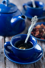 Blue cup of tea. (lyule4ik) Tags: china blue white plant green art english classic peru cup horizontal breakfast dinner ceramic table leaf afternoon dish tea drink eating object empty traditional beverage over creative plate nobody photograph romantic dining british studioshot dried delicate popular herbaltea coca porcelain medicinal saucer peruvian colorphoto elegance tableware ingredient medicinalplant alternativemedicine erythroxylumcoca
