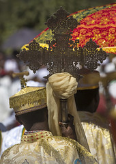 Ethiopian Orthodox Priest Holding A Cross During The Colorful Timkat Epiphany Festival, Lalibela, Ethiopia (Eric Lafforgue) Tags: africa travel people men vertical religious outdoors photography worship day cross adult faith religion ceremony multicoloured icon parade christian unescoworldheritagesite unesco holy event textile devotion sacred crucifix destination mystical ritual priest spirituality rearview tradition ethiopia ornate spiritual orthodox cultures pilgrimage worshipper religiouscelebration oneperson developingcountry traditionalculture lalibela humaninterest orthodoxy lifestyles hornofafrica epiphany ethiopian eastafrica placeofworship mysticism worldculture traditionalclothing realpeople traveldestinations traditionalfestival onlymen onemanonly timket onematuremanonly timkat traditionalceremony copticchristianity timqat publiccelebratoryevent religiousequipment liturgicalparasol ethio1409877