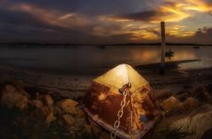 Forgotten. (williams.darrell53) Tags: light sky cloud sun seascape water rock canon boat williams australia darrell samyang