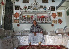 Ethiopian woman inside her decorated harari house, Harari region, Harar, Ethiopia (Eric Lafforgue) Tags: africa woman house flower color heritage smiling horizontal architecture outdoors photography ancient women day adult display furniture interior decoration multicoloured indoor unescoworldheritagesite indoors sit destination ethiopia cheerful plasticflowers cushion abundance oneperson developingcountry hornofafrica harrar eastafrica harar abyssinia traditionalclothing largegroupofobjects fulllenght harari oromo traveldestination 1people harer harariregion jugol hararjugol harergey ethio162975