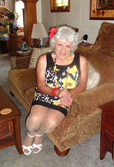A Woman At Home (Laurette Victoria) Tags: woman silver necklace dress sofa milwaukee laurette