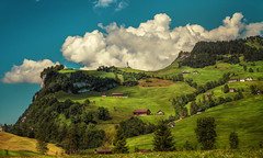 up there (Chrisnaton) Tags: green clouds landscape switzerland hill bluesky