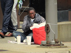 Homeless and Hungry in Chicago (Renee Rendler-Kaplan) Tags: city summer people chicago corner canon bag him outside outdoors sitting july cups jacket stuff sit there summertime michiganavenue he seated wbez heatwave chicagoillinois ignored chicagoist 2016 chicagoreader peoplewalking frommycarwindow peoplewalkingby reneerendlerkaplan canonpowershotsx530hs
