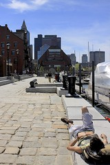 Harborwalk (oxfordblues84) Tags: sky man building brick guy boston architecture buildings hotel massachusetts belly tanning suntanning bostonmassachusetts harborwalk bostonmarriottlongwharf guysuntanning