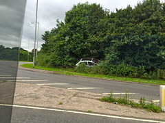 Car Crash - Strange Place to Park a Car! (Paul.Bevan) Tags: road lighting weeds shropshire offroad streetlamps litter streetfurniture bushes ontheroad bollard carcrash policetape bluecar a41 trafficaccident chevrons crashedcar familysaloon carintrees