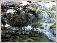 Stone on water (PeepeT) Tags: lake stone wave kivi aalto jrvi