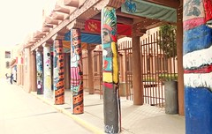 """MANKIND HAS LEGS SO IT CAN WANDER. (Irene2727) Tags: city urban newmexico santafe color architecture outdoors cityscape architecturaldetail perspective citylife poles scape"