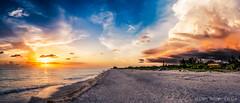 Stormy Sunset (DonMiller_ToGo) Tags: sunset sky gulfofmexico nature clouds landscape spring seascapes florida sunsets g5 beaches thunderstorm storms goldenhour onawalk hardlight beachphotography manasotabeach myflorida sunsetmadness sunsetsniper panoimages8