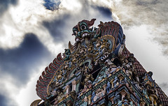 Meenakshi Amman Temple (Tiklaas) Tags: sky sculpture india detail clouds temple asia head colorfull religion amman hinduism madurai sculptures tamil tamilnadu meenakshi kovil meenakshiammantemple meenakshisundareswarartemple meenakshiammankovil sundareswarar tiruaalavaai aalavaai
