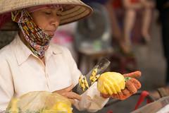 Pineapple Hawker (Pexpix) Tags: fruit hanoi hawker nikkoraf85mmf14d nikondf outdoors pineapple vietnam hni