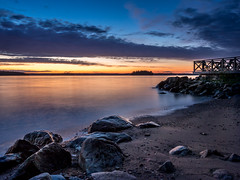 Into the Night (Jens Haggren (off for a while)) Tags: light sunset sea sky seascape beach water clouds landscape evening seaside rocks view sweden olympus em1 nacka