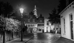 Onze Lieve Vrouwe Toren in the distance (kjeldvdh) Tags: nikon d5500 night light street amersfoort nethrlands nederland utrecht provincie land serene empty abandon cool scape cityscape nightscape bridge medieval old europe lamp streetlamp dark bw grey gray bright dynamic havik city centre depth noiretblanc white black house history