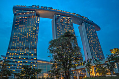 Marina HDR FAD (Kaniz Khan 2009) Tags: trees building architecture lights hotel singapore nightshot bluesky landmark structure infrastructure tall marinabay shiponsky