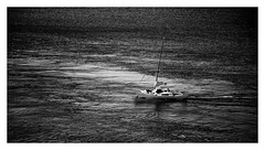 the encounter (kurtwolf303) Tags: ocean sea bw man topf25 monochrome dark person boat topf50 topf75 meer sailing 500v20f sw dunkel segelboot 800views 750views 250v10f unlimitedphotos canoneos600d