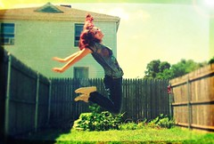 Jump Around! (Katanaspictographs) Tags: girl green garden grass high buildings aesthetic blue flower color flowers colors close artsy art nature roof posed