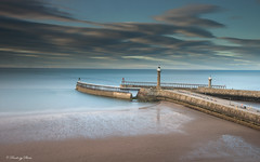 Whitby Piers, North Yorkshire, England, Uk, Gb. (PANDOOZY PHOTOS) Tags: whitby pier piers harbour sea coast coastline british english greatbritain england uk gb yorkshire northyorkshire touristattraction seaside beach travel clouds beacons sand stone structure tower low tide nature tourism