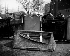 Two Old Sofa And Some Bins - Newcastle (Richard James Palmer) Tags: mamiya7ii mamiya 7ii 80mm ilford hp5 ilfordmicrophen microphen ishootfilm shoot film iso 400 iso400 ilfordhp5 f4 newcastle northeast north east street photography landscape black white rangefinder medium format 120 filmisnotdead analogue documentary epsonperfectionv700 epson v700 1125 landscapes newcastleupontyne upon tyne tyneandwear northern uk england urban melancholy art fineart new isolated walkabout 2016 gritty gloomy trapped blackandwhite monochrome