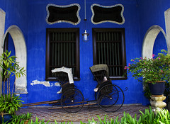 The Blue House (Jon and Sian Bishop) Tags: malaysiaphotography malaysia photography penang island georgetown george town sea southeastasia asia summer july hot humid canon canoneos550d eos550d 550d cheongfatttze blue mansion house thebluehouse history chinese culture malay royalblue windows plants arches tile pot potplants plaster renovated rickshaw